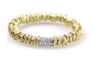 Jolly large elastic bracelet in yellow gold with white diamonds