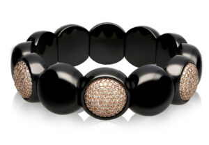 Dama, stretch bracelet in 18k gold with white and black diamonds and high tech ceramic