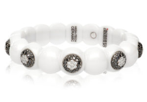 Dama, stretch bracelet in 18k gold with black and white diamonds and high tech ceramic