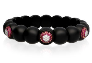Dama, stretch bracelet in 18k gold with white diamonds, rubies and high tech ceramic