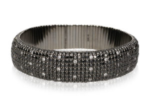 Giotto, stretch bracelet in 18k gold, black and white spot diamonds