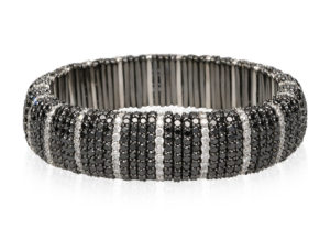 Giotto, stretch bracelet in 18k gold, black and white diamonds