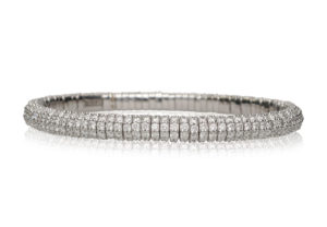 Giotto, stretch bracelet in 18k gold and white diamonds