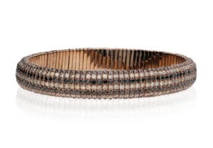 Giotto, stretch bracelet in 18k gold, brown and black diamonds