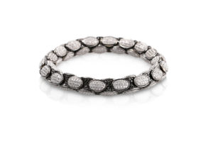 Anaconda bracelet in 18k gold with white and black diamonds